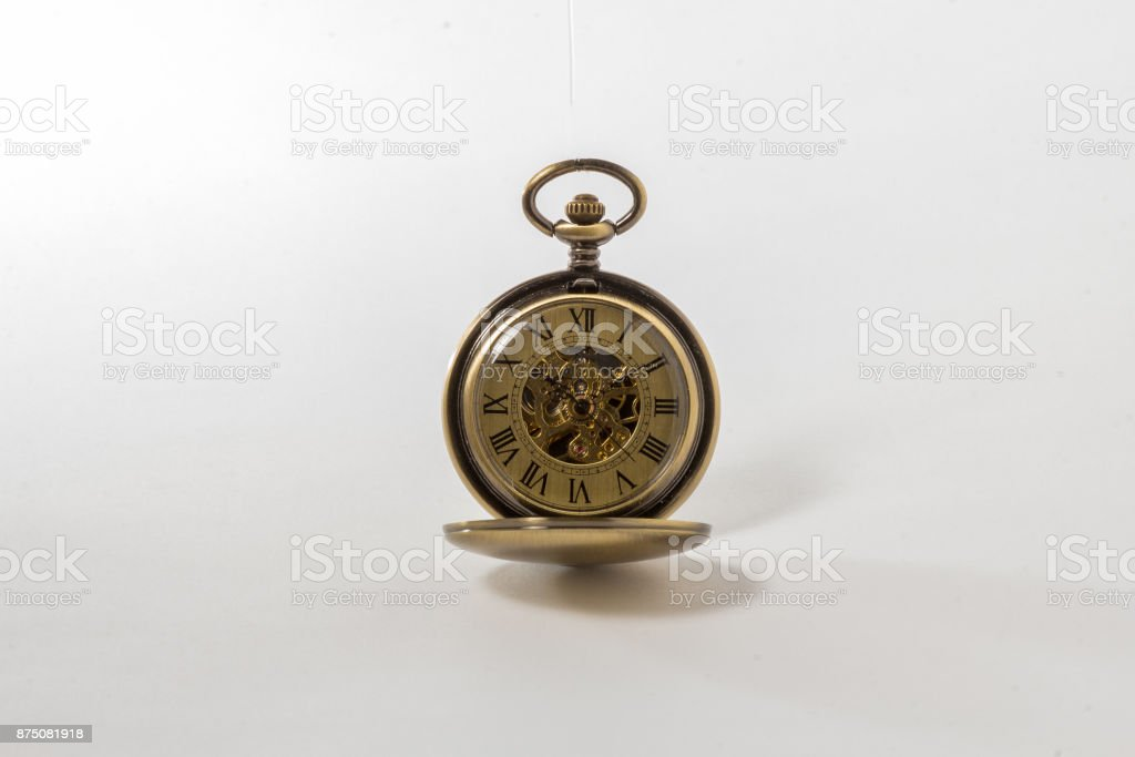 Old time pocket watch, with inner gears showing. stock photo