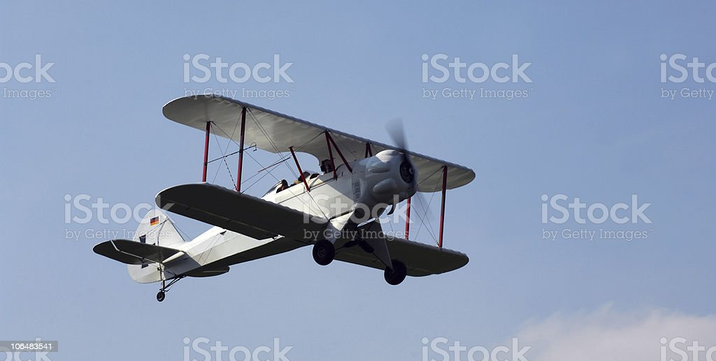 Old time propeller powered bi-plane stock photo