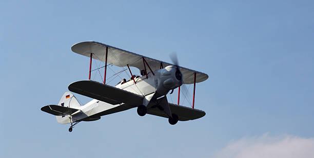 Old time propeller powered bi-plane stock photo