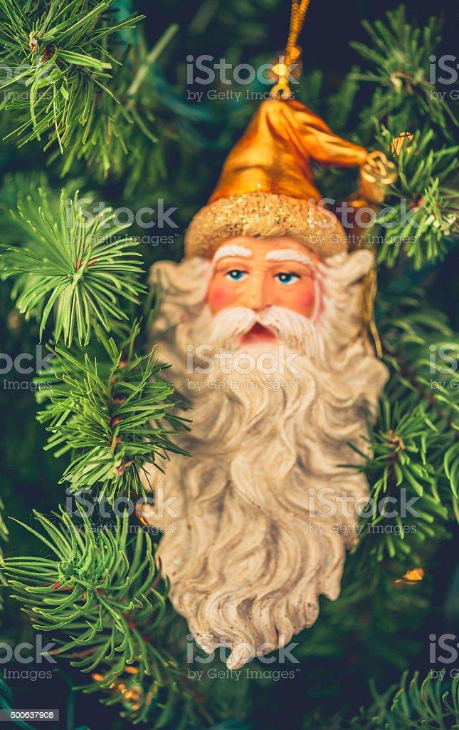 old time santa ornament on christmas tree royalty free stock photo