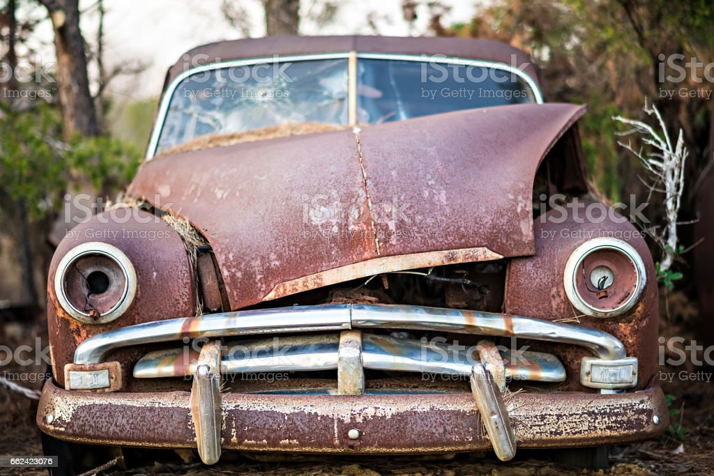 old timer abandoned automobile on the farm stock photo