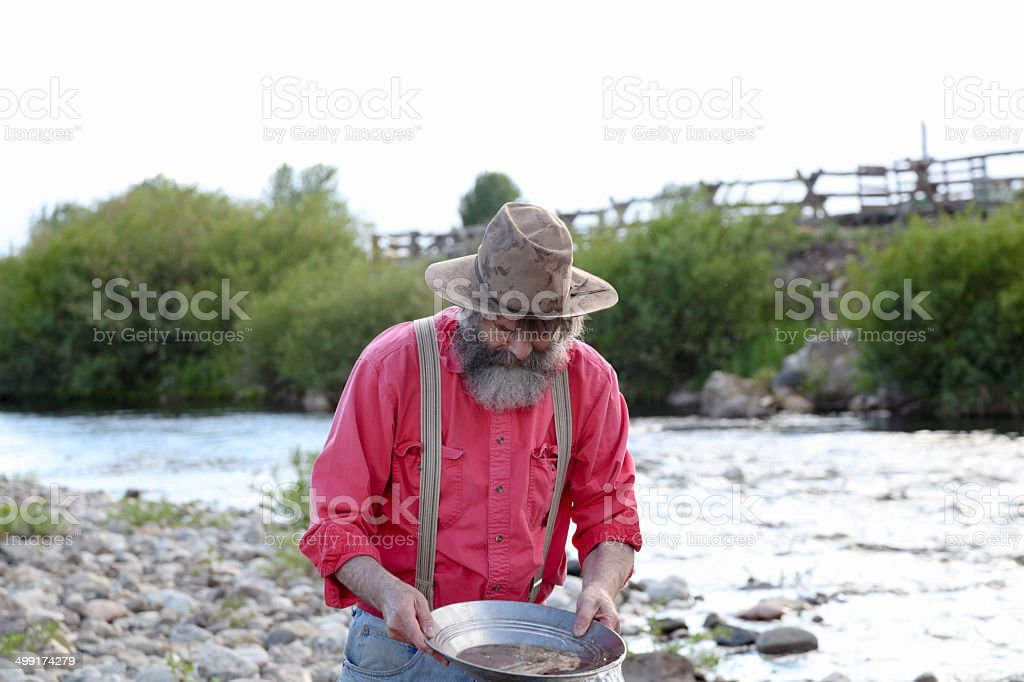 old timer western prospector panning gold river Montana USA stock photo