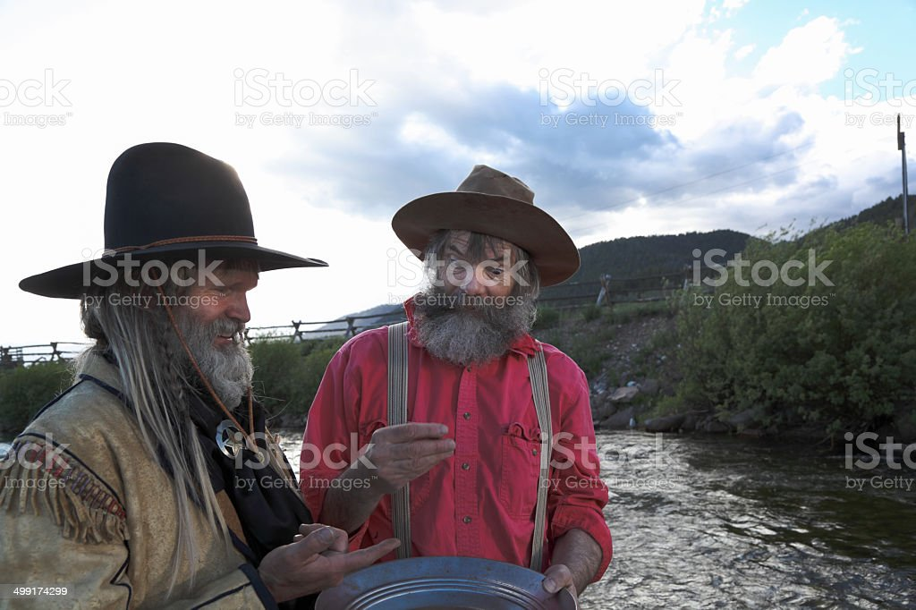 old timer western prospectors panning gold river Montana USA stock photo