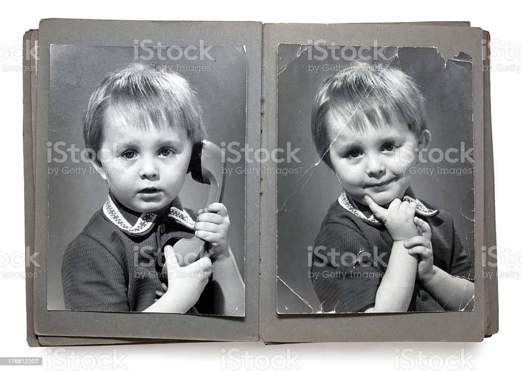 Old times style photobook of a child posing with a telephone stock photo
