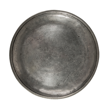 Old tin plate isolated on a white background