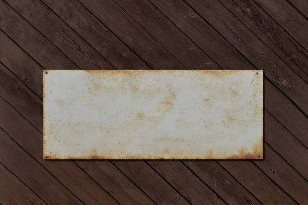 Old tin sign for text template on an old wooden wall stock photo