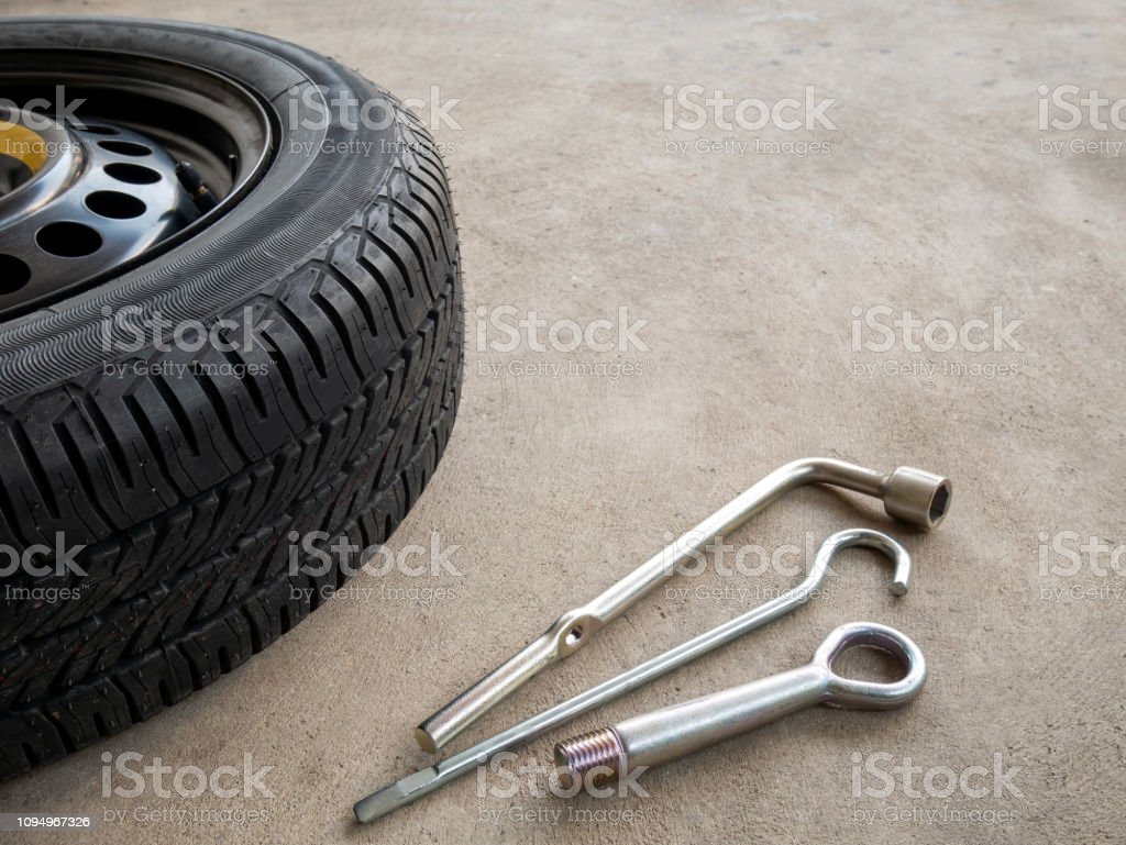 Old tire and tools of car park on the street stock photo