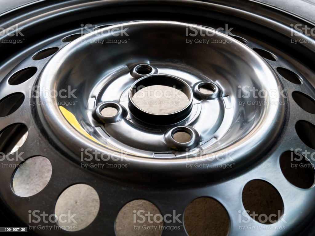 Old tire of car park on the street stock photo