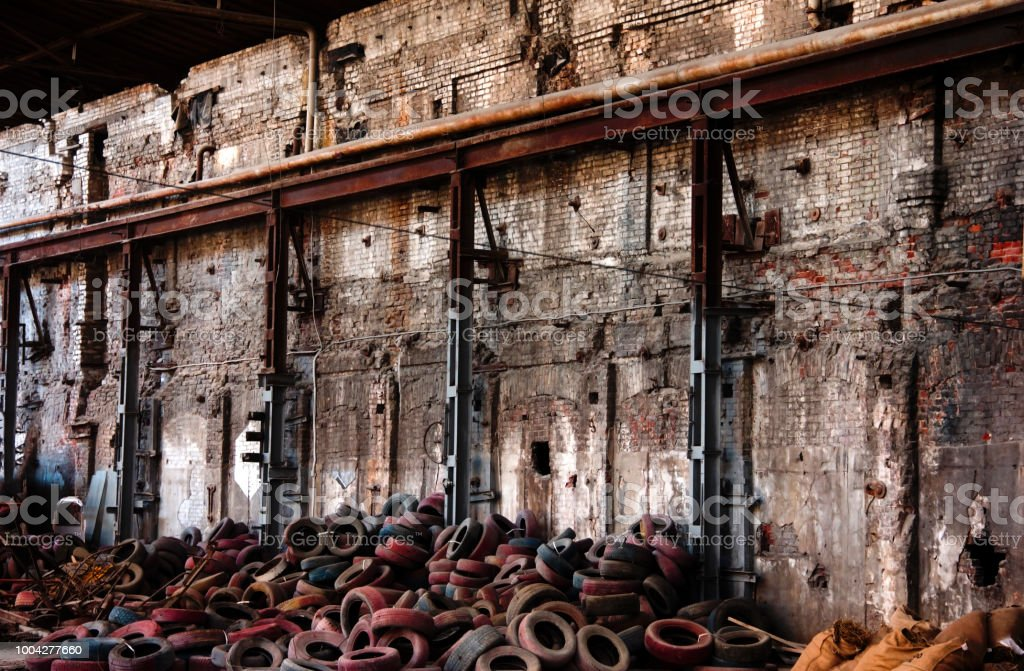 Old tires in brownfield site stock photo