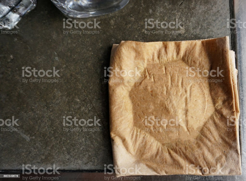 Old Tissue paper on wooden table stock photo