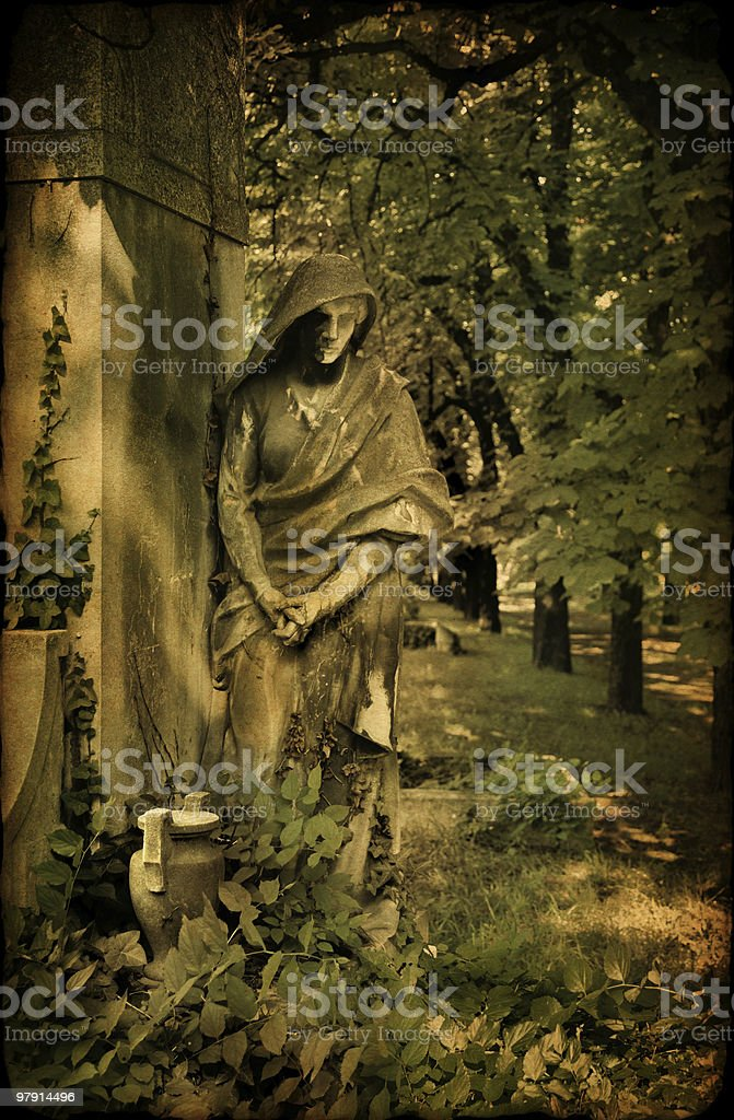 old tomb with a monk's statue royalty-free stock photo