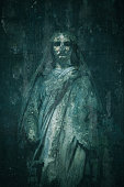 Old tombstone of Virgin Mary - Catholicism and Religion - Spooky ghost - Cemetery Pere Lachaise, Paris, France
