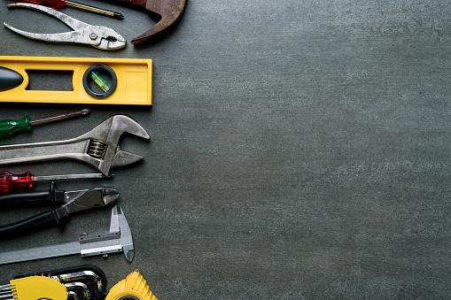 Old tools on black background