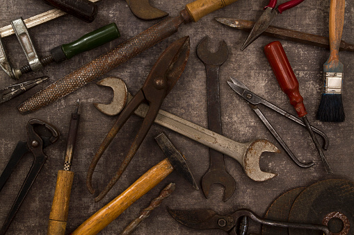 Old Tools on Rustic Background
