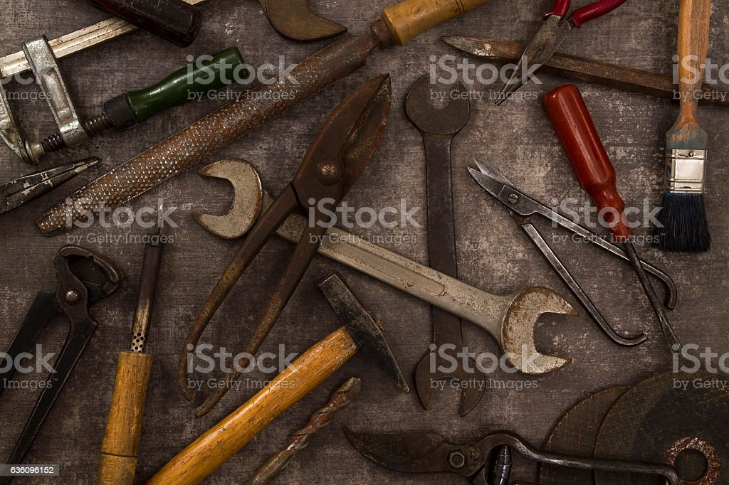 Old Tools on Rustic Background stock photo