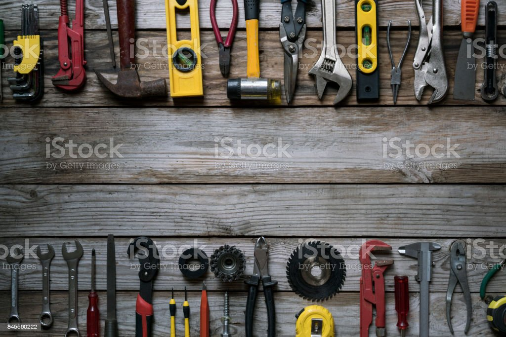 Old tools on wood table background stock photo