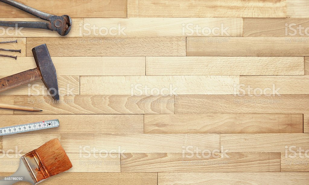 Old tools on wooden table with free space for text. stock photo