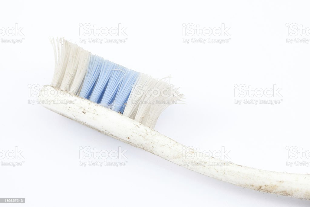 old toothbrush on white background royalty-free stock photo