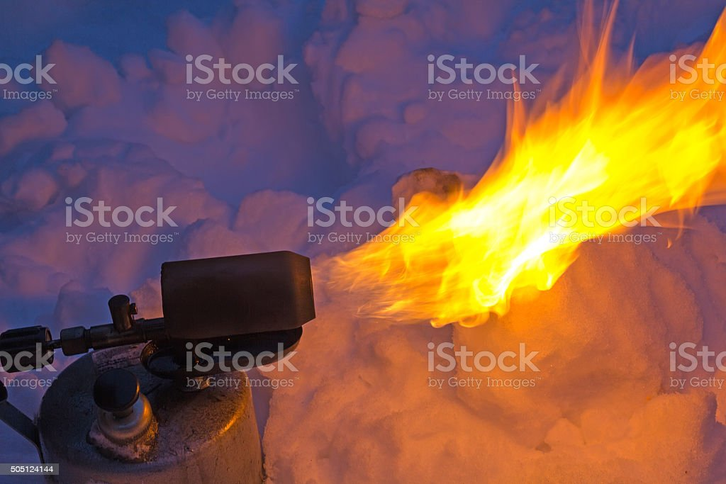 Old torch with a flame stock photo