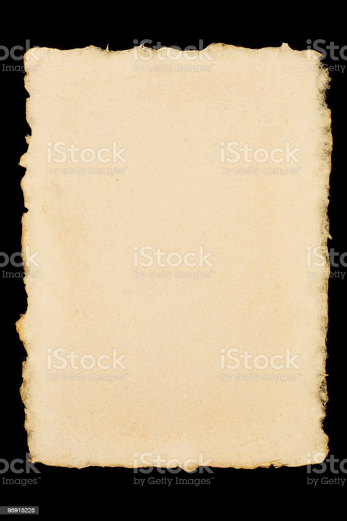 Old torn paper isolated on a black background stock photo