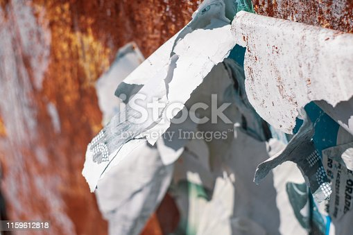 924754302 istock photo Old Torn Paper Texture On Rusty Metal Wall 1159612818