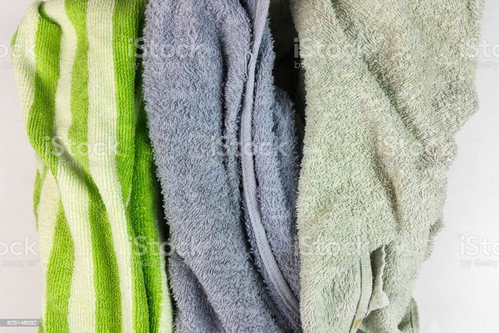old towels on white background - top view stock photo