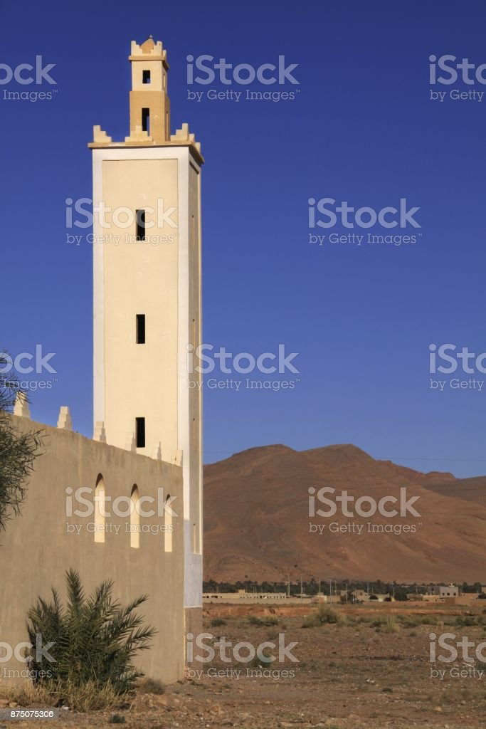 Isolated Tall Tower of old Mosque and Desert Plain Landscape south of...