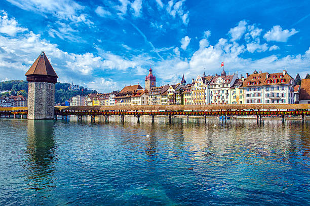 old tower and bridge at lucerne switzerland - lucerne stock pictures, royalty-free photos & images