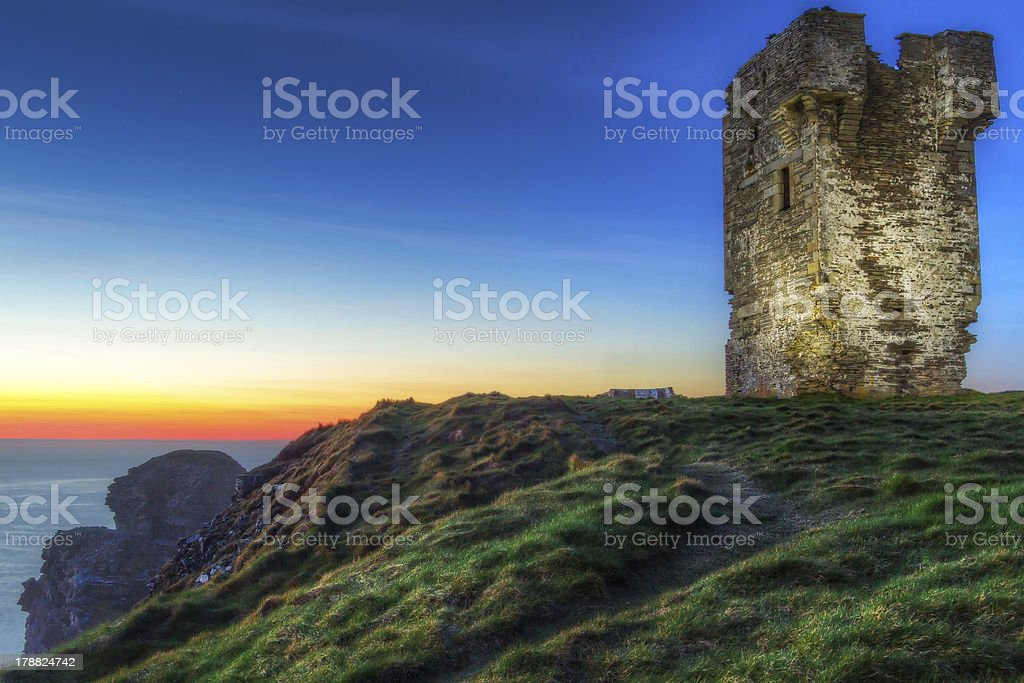 Old tower on Cliffs of Moher at dusk stock photo