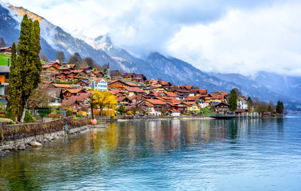 Old town and Alps mountains on Brienzer Lake, Switzerland Old town of Oberried, Brienz, Interlaken and misty Alps mountains reflecting in lake, Switzerland switzerland stock pictures, royalty-free photos & images