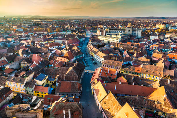 old town and city skyline of sibiu in transylvania, romania - romania stock photos and pictures