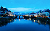 Panoramic view with Landscape of Old town and Hohensalzburg castle in Salzburg in Austria in Europe. Mozart city in Austrian Alps at Salzach River in winter. Fortress and Cathedral. In evening