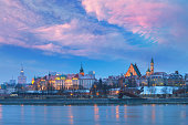 Panorama of the Old Town with reflection in the Vistula River at sunset, Warsaw, Poland.