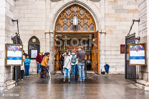 Montreal: Old town area with Notre Dame Basilica during day and people in Quebec region city
