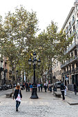Barcelona, Spain - November 2, 2014: Tourists and people walking in Passeig del Born