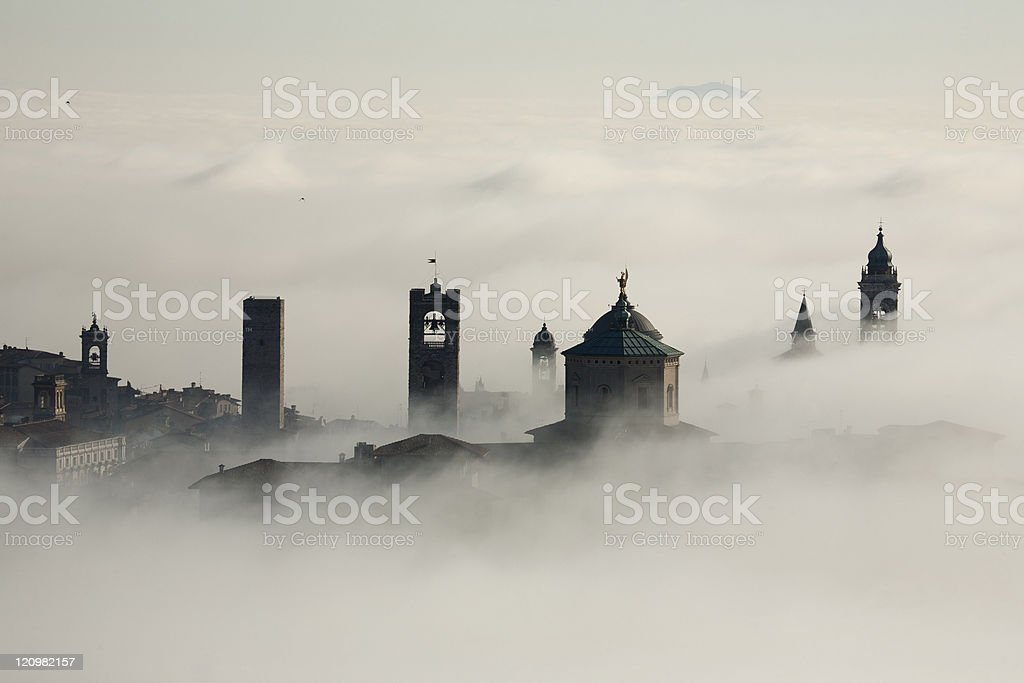 Old town Bergamo Into the fog stock photo