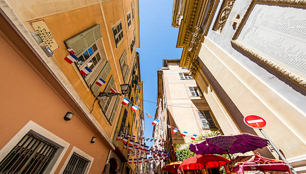 Old town flags in Nice, France stock photo