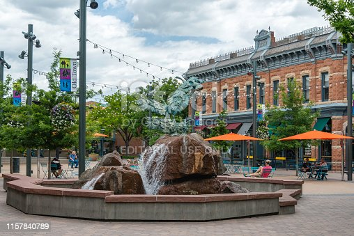 People relaxing in the quaint Old Town section of Fort Collins, Colorado.