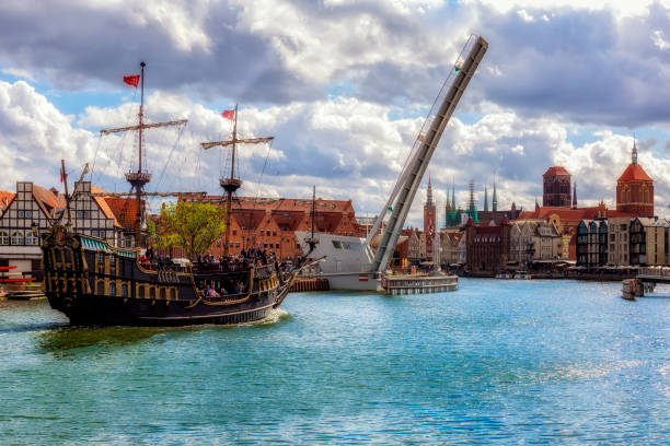Old Town Gdansk in summer, Poland The classic view of Gdansk Old Town with the Hanseatic-style buildings and tourist sailing ship transports tourists across the River Motlawa to the Baltic Sea for a cruise, Poland bascule bridge stock pictures, royalty-free photos & images