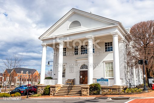 istock Old town hall colonial architecture with sign for Huddleson Memorial in Fairfax 1212746067
