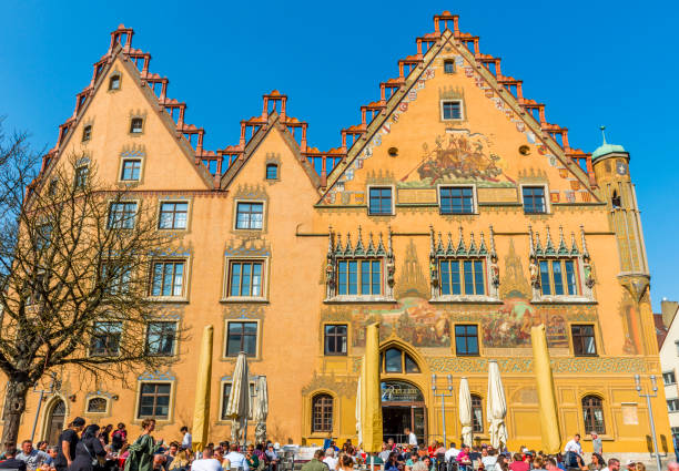 Old town hall in Ulm in Germany Ulm, Germany - March 23, 2019: Old town hall in Ulm, built in 1370, the facade is full with paintings from the mid-16th century. Nowadays is a brewery and a restaurant inside. ulm stock pictures, royalty-free photos & images