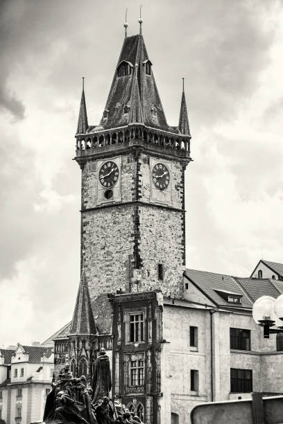Old town hall with Jan Hus memorial in Prague, Czech republic, colorless Old town hall with Jan Hus memorial in Prague, Czech republic. Architectural scene. Travel destination. Black and white photo. astronomical clock prague stock pictures, royalty-free photos & images