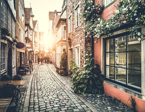 Old town in Europe at sunset with retro vintage Instagram style filter effect.