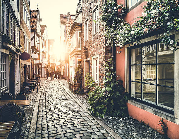 old town in europe at sunset with retro vintage filter - european culture stock photos and pictures
