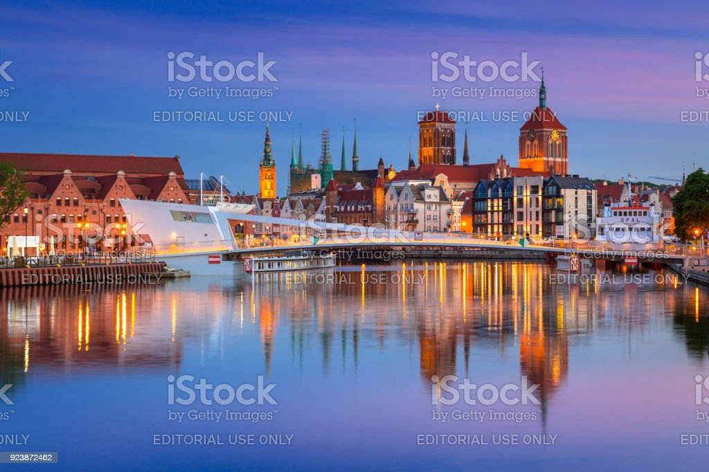 Old town in Gdansk and catwalk over Motlawa river at dusk stock photo