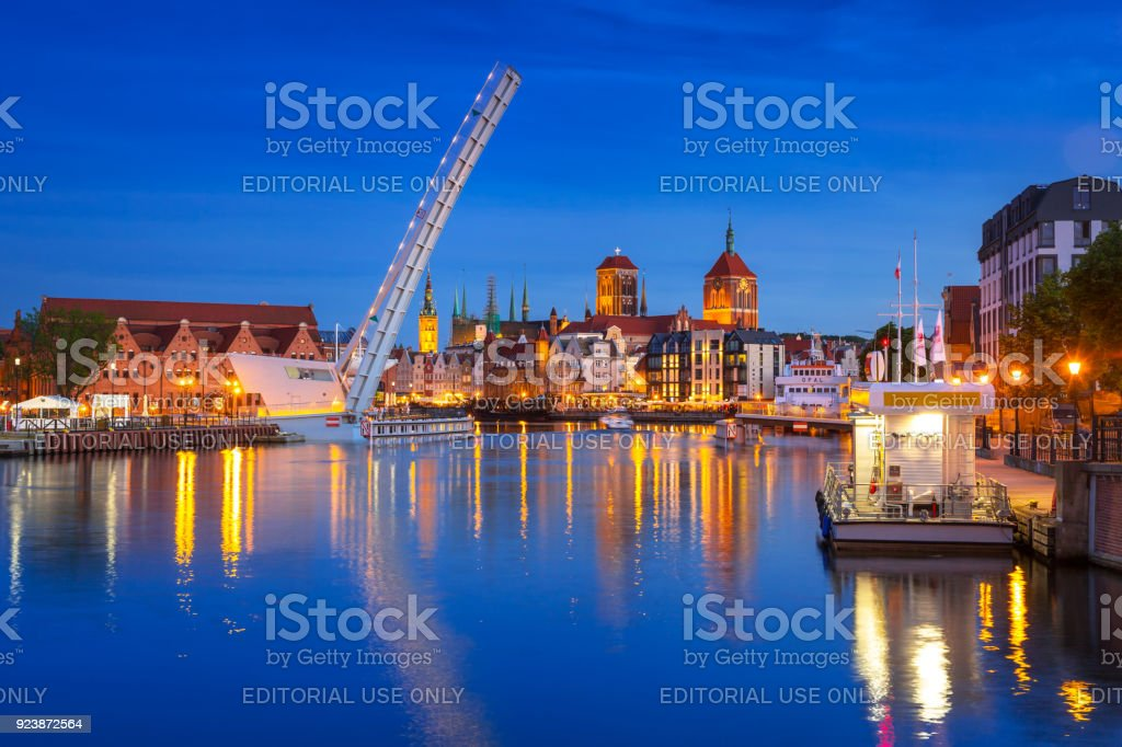 Old town in Gdansk and catwalk over Motlawa river at sunset stock photo