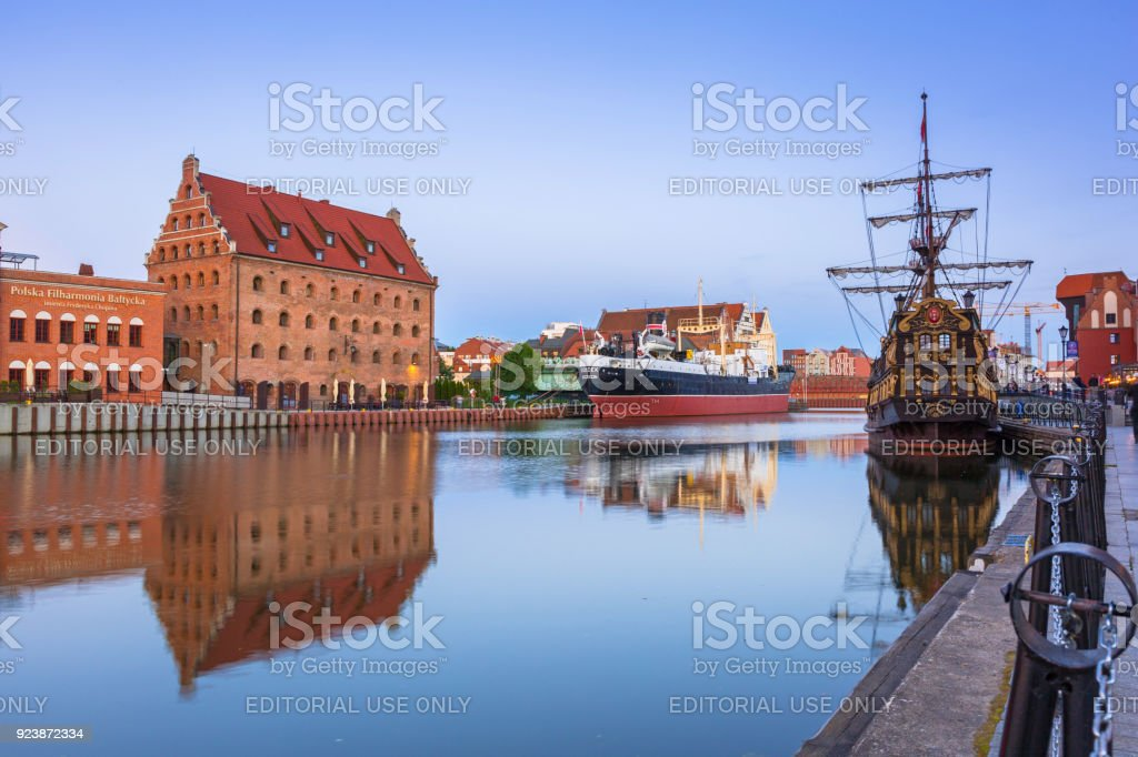 Old town in Gdansk over Motlawa river at dusk stock photo