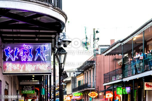 938895626 istock photo Old town in Louisiana famous city with Bourbon street Krazy Korner neon sign 1209968818
