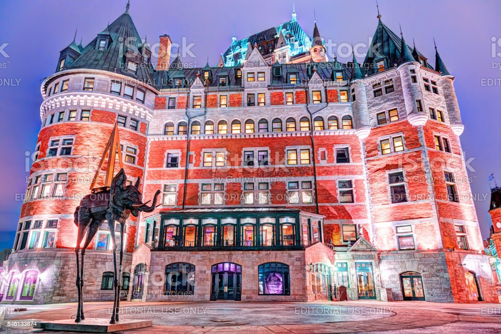 Old town night colorful view of Fairmont Chateau Frontenac and purple clouds during twilight stock photo