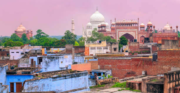 Old town of Agra with Taj Mahal, India Old town of Agra with Taj Mahal in background on sunset, Agra, India agra stock pictures, royalty-free photos & images
